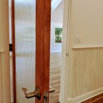 stained wood interior door with reeded glass